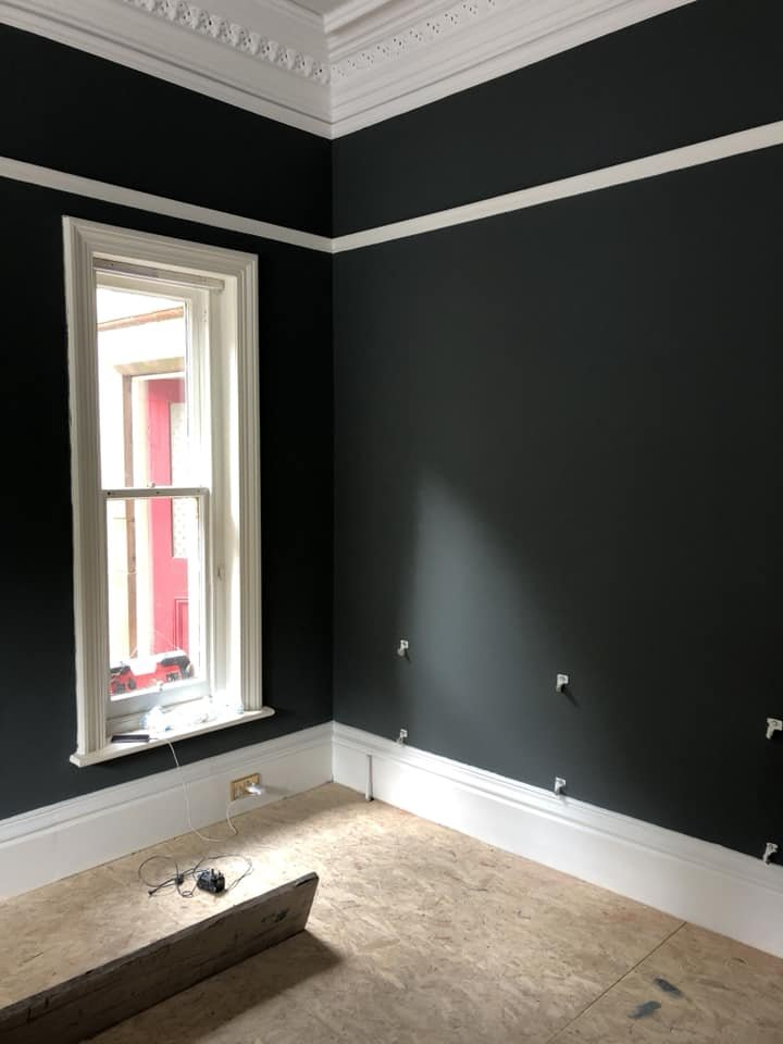 White window and dark grey walls in room