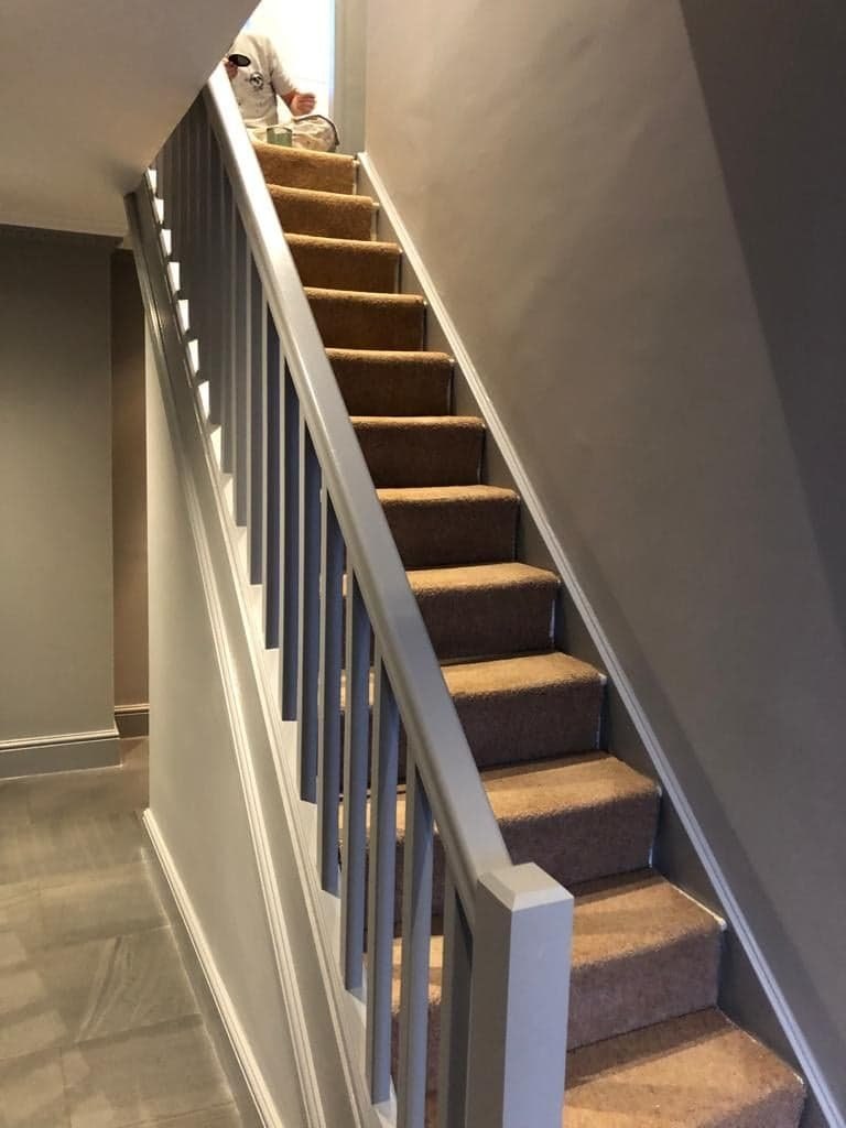 Grey walls and bannisters painted with satin finish
