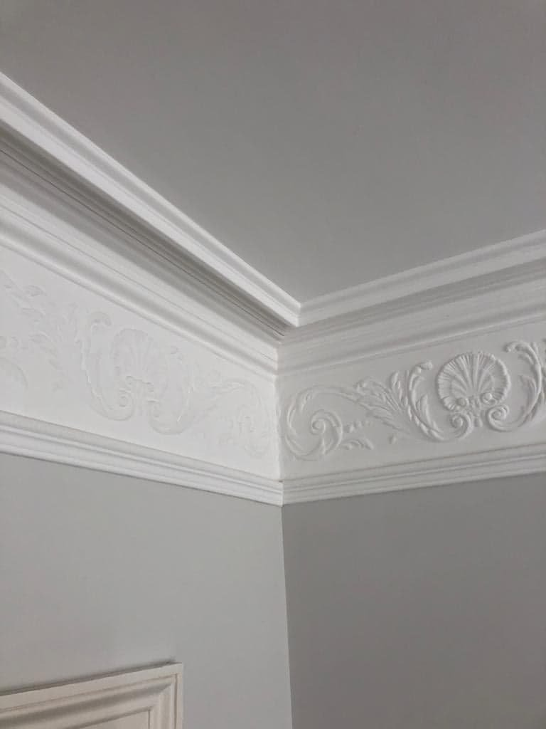 Painted coving and frieze with white emulsion