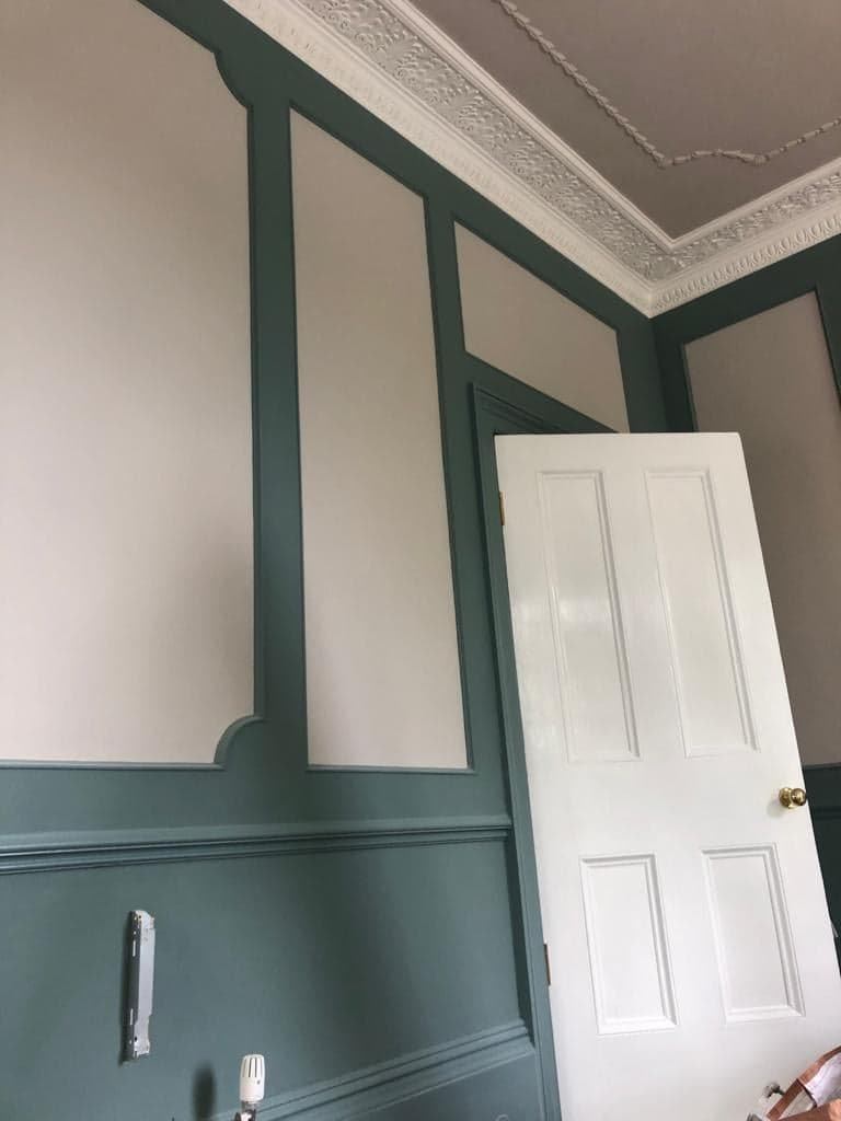Decorating contrast with multiple paints applied to walls and door