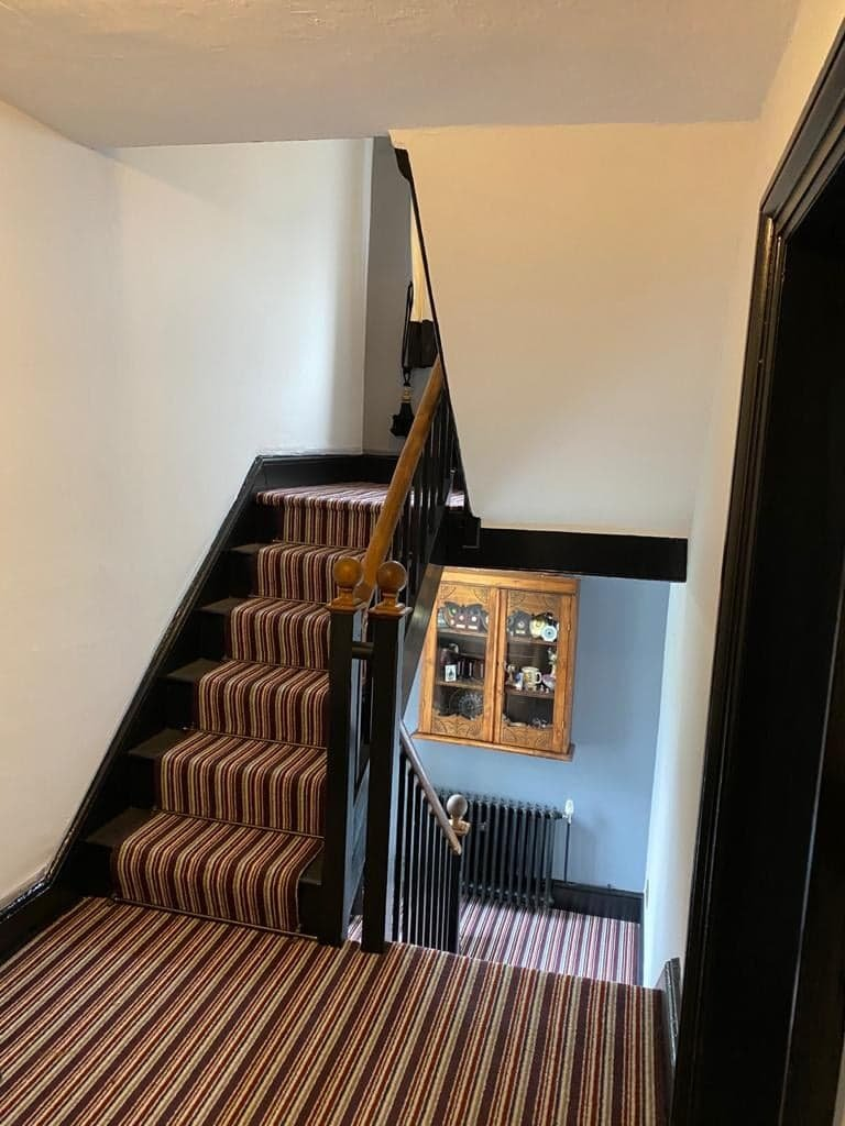 Black woodwork with satin finish on staircase