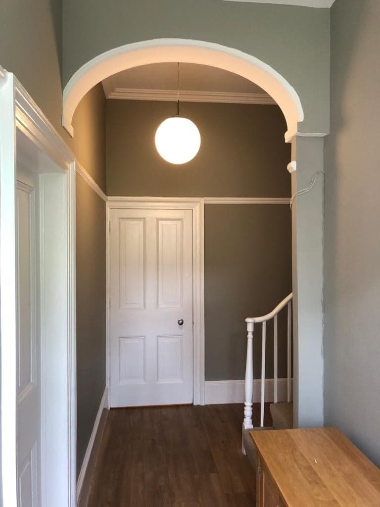 White woodwork and bannisters with painted hallway